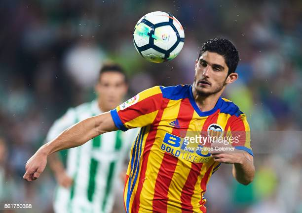 Goncalo Guedes of Valencia CF in action scoring during the La Liga match between Real Betis and Valencia at Estadio Benito Villamarin on Octob