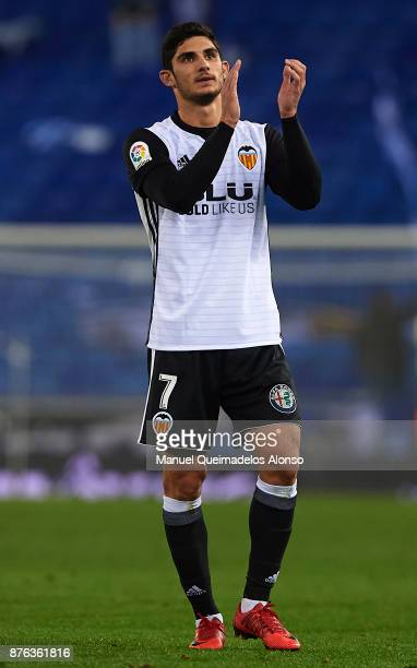 Goncalo Guedes of Valencia greets the fans after the La Liga match between Espanyol and Valencia at CornellaEl Prat stadium on November 19 2017 in...