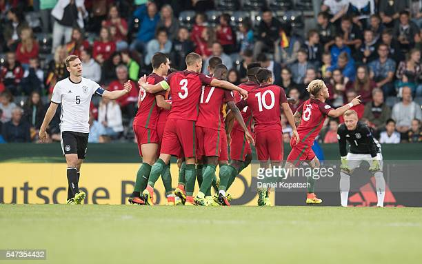 Goncalo Rodrigues of Portugal celebrates his team's second goal with team mates during the UEFA Under19 European Championship match between U19...