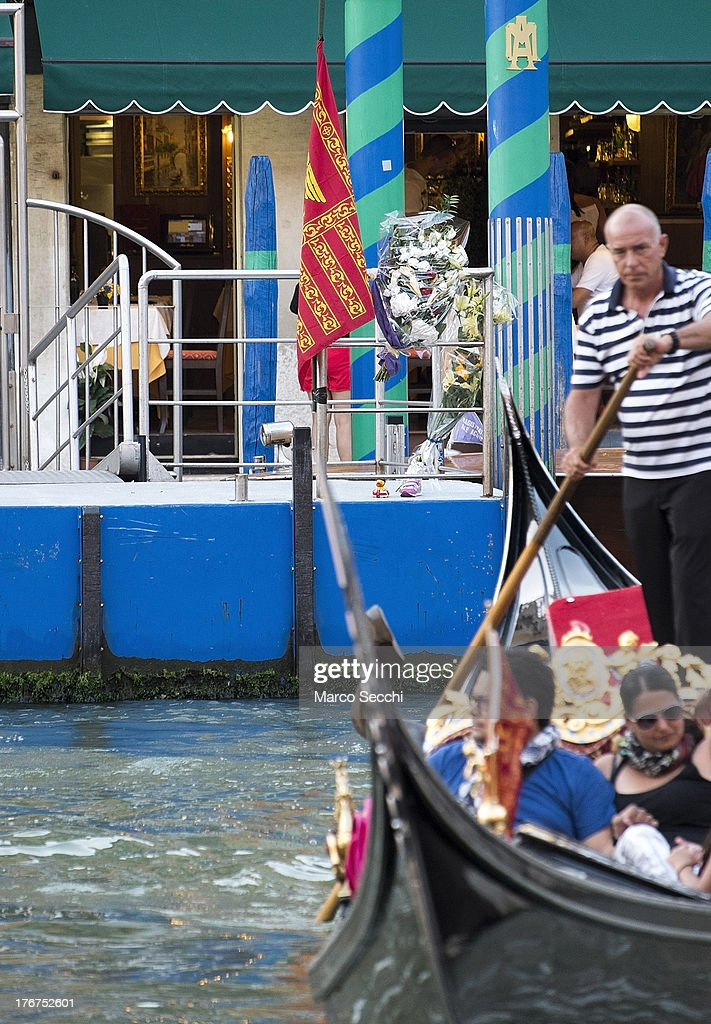 A Gondola draped in mourning sails in front of the pontoon where on August 17 a German tourist was killed on August 18, 2013 in Venice, Italy. A German tourist was crushed to death on Saturday when the gondola he was boarding collided with a waterbus (Vaporetto) along Venice's Grand Canal.
