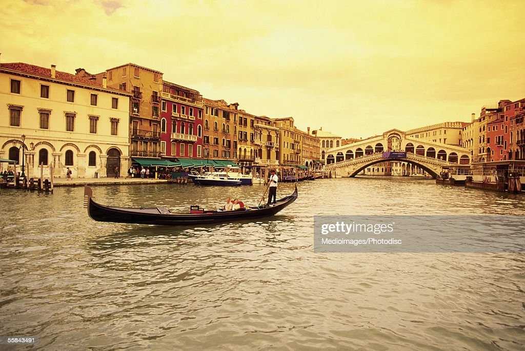 Gondola in a canal, Rialto Bridge, Venice, Italy : Stock Photo