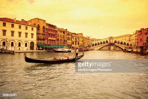 Gondola in a canal, Rialto Bridge, Venice, Italy : Stock Photo