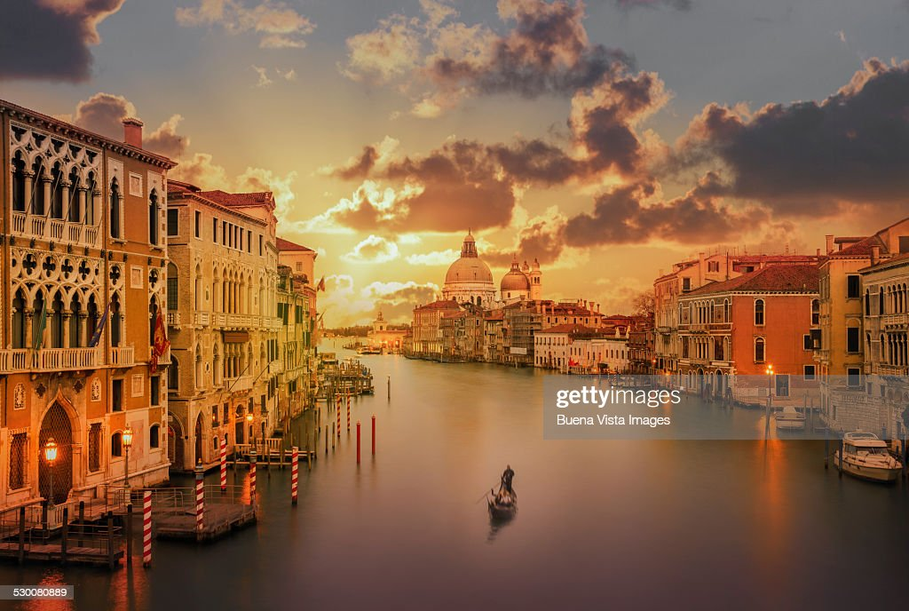 Gondola in the Grand Canal at sunset : Stock Photo