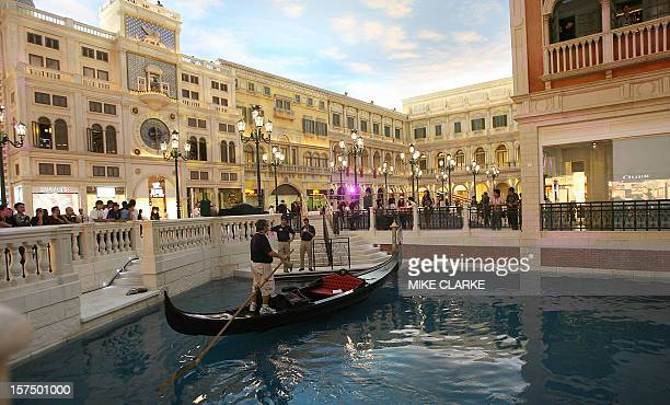 A gondola is moored indoors at 'St Marks Square' at the Venetian Resort in Macau 27 August 2007 a day before the 24 billion USD gamble opens to the...