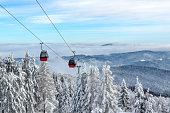 Gondola ski lift on a background of a picturesque winter mountain
