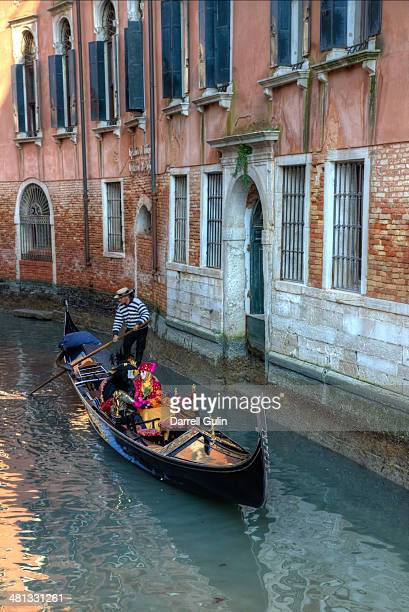 Gondola, masked riders in canals of Venice