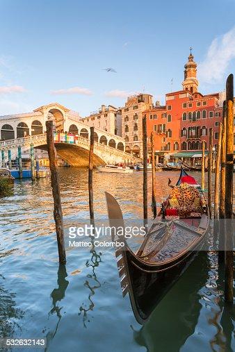 Gondola moored at sunset at Rialto bridge, Venice