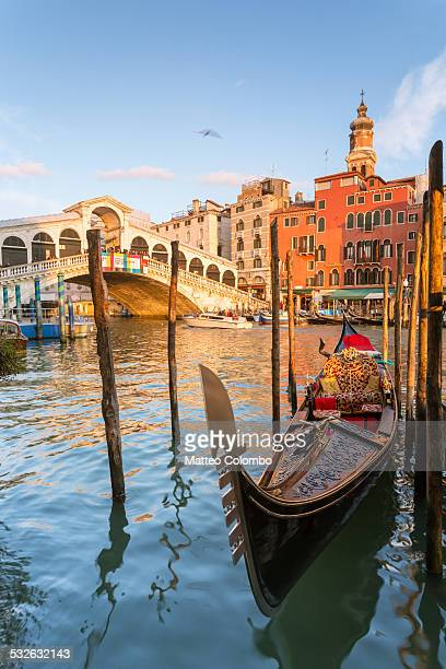 Gondola moored at sunset at Rialto bridge, Venice