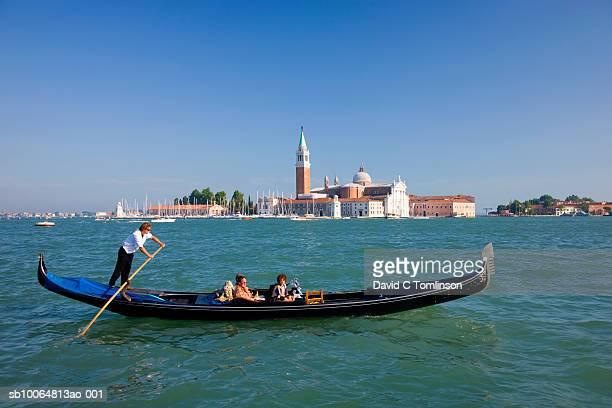 Gondola on lagoon, San Giorgio Maggiore Church in background, Venice, Veneto, Italy