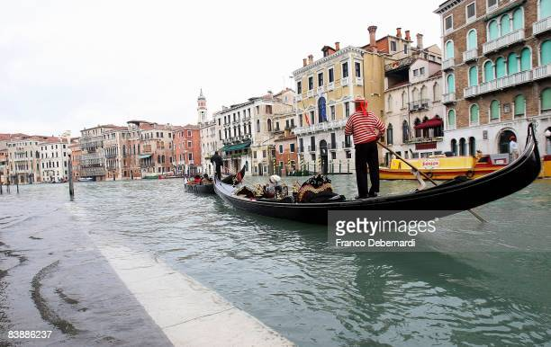 A gondola passes through flood waters near Rialto Bridge on December 2 2008 in Venice Italy Strong coastal winds led to the city of Venice being...