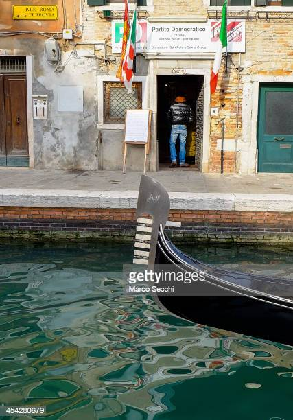 A gondola sails in front of a Democratic Party polling station during today primary elections on December 8 2013 in Venice Italy Italians are voting...