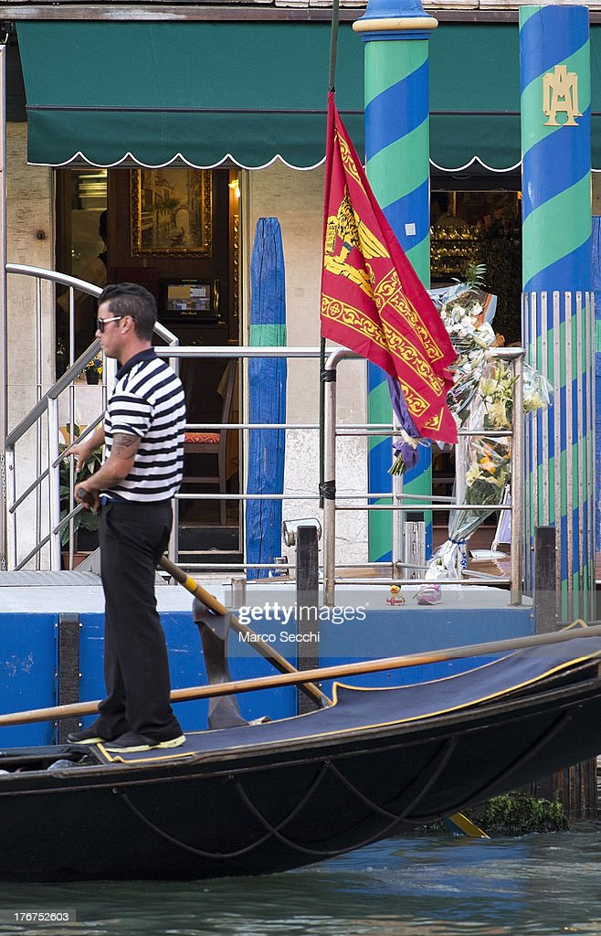 A Gondola sails in front of the pontoon with flowers and a Venice flag where on August 17 a German tourist was killed on August 18, 2013 in Venice, Italy. A German tourist was crushed to death on Saturday when the gondola he was boarding collided with a waterbus (Vaporetto) along Venice's Grand Canal.