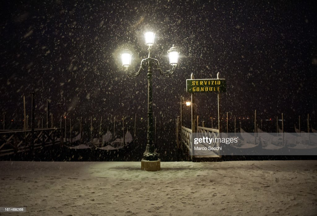 A gondola staion is seen in heavy snow in Saint Mark's Square on February 11, 2013 in Venice, Italy. Heavy snow, High water, wind and rain has been forcasted for today.