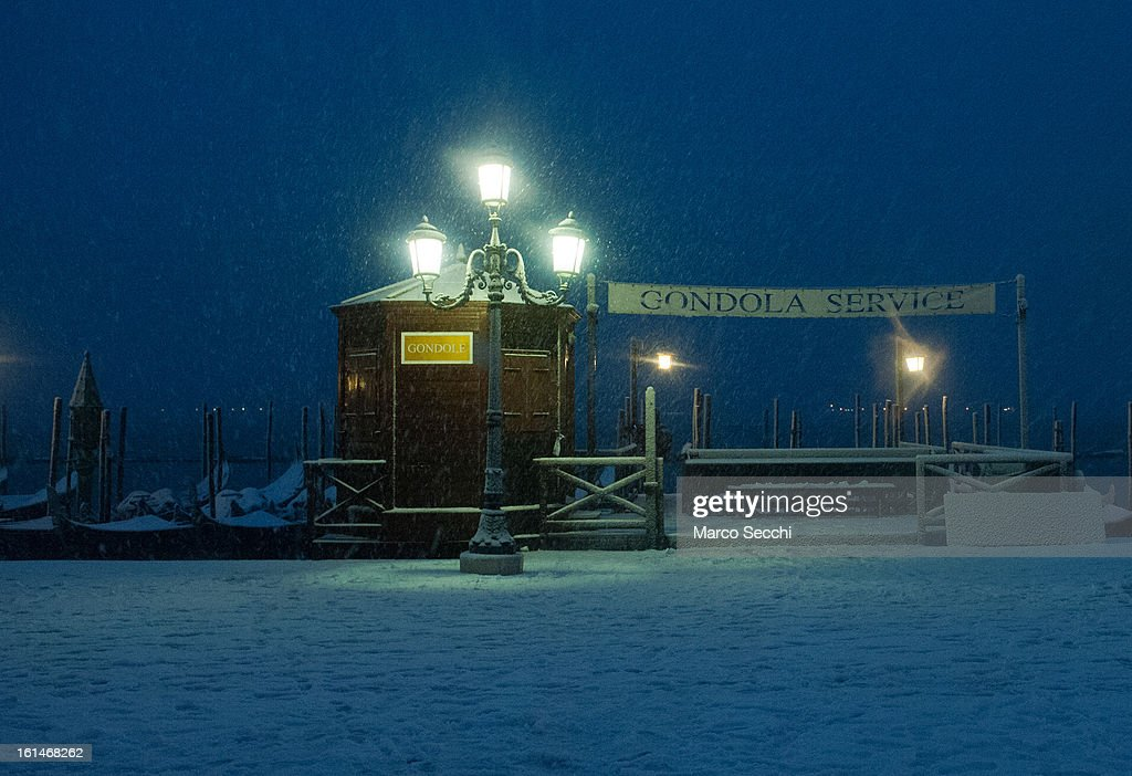 A gondola station on the Saint Mark's Basin is seen in heavy snow on February 11, 2013 in Venice, Italy. Heavy snow, High water, wind and rain has been forcasted for today.