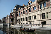 A gondola takes tourists on a canal along a replica of Europeanstyle houses at Dalian's 'City of Water' The City of Water also dubbed Venice of the...