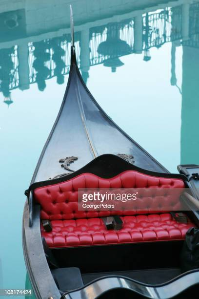 Gondola with Reflections of Railing in Water