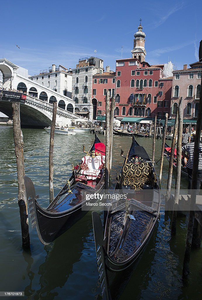 Gondolas are parked at the same pontoon where few hours earlier a German tourist was crashed to death on August 17, 2013 in Venice, Italy. A German tourist was crushed to death on Saturday when the gondola he was boarding collided with a waterbus (Vaporetto) along Venice's Grand Canal.