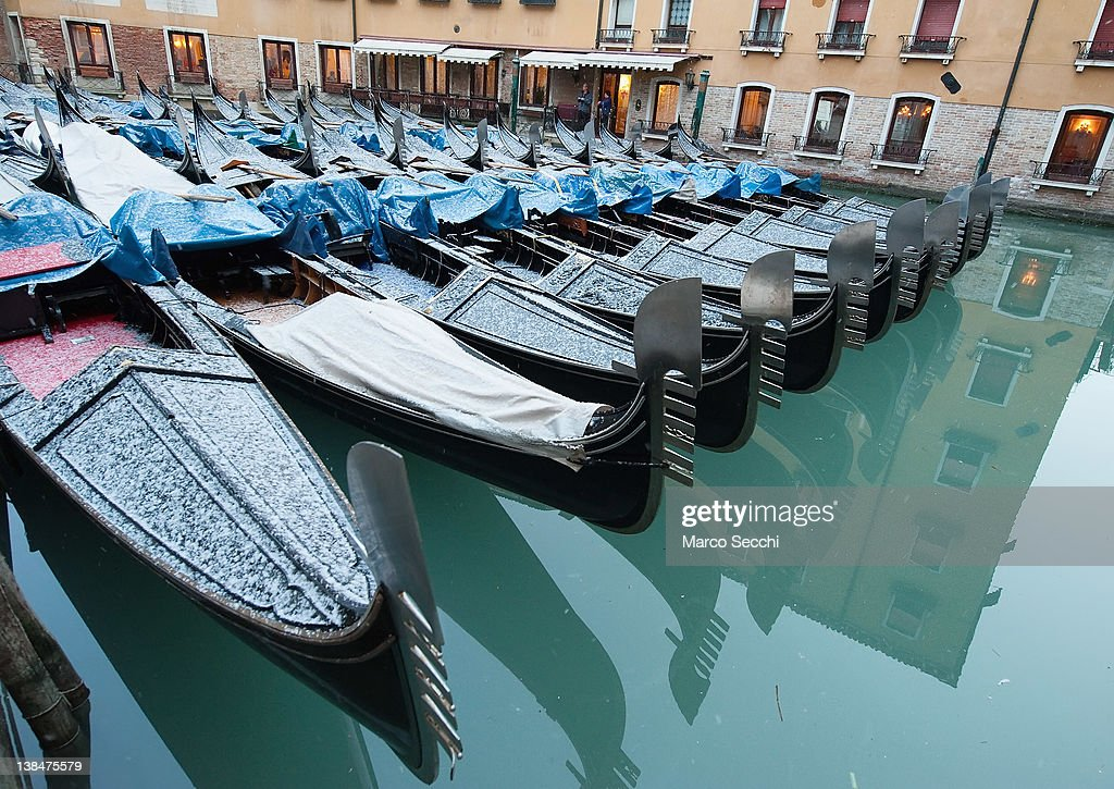 Gondolas covered by a snow flurry are seen in Bacino Orseolo on February 7, 2012 in Venice, Italy. Italy, like most of Europe, is experiencing freezing temperatures, with the Venice Lagoon freeezing for the first time in over 20 years.