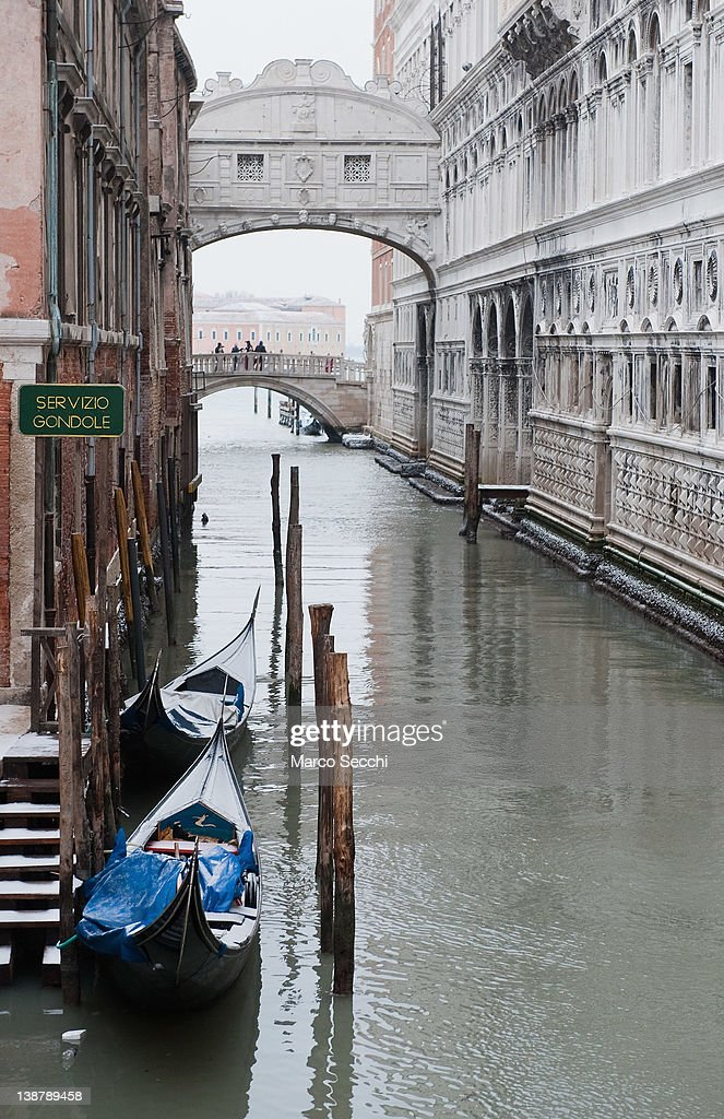Gondolas covered with snow are moored next to the world famous Bridge of Sighs on February 12, 2012 in Venice, Italy. Italy, like most of Europe, is experiencing freezing temperatures, with the Venice Lagoon freeezing for the first time in over 20 years.