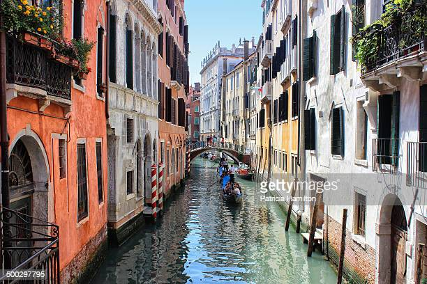 CONTENT] Gondolas going under a little bridge in a picturesque side canal in Venice Tourist destination Relaxation on vacation