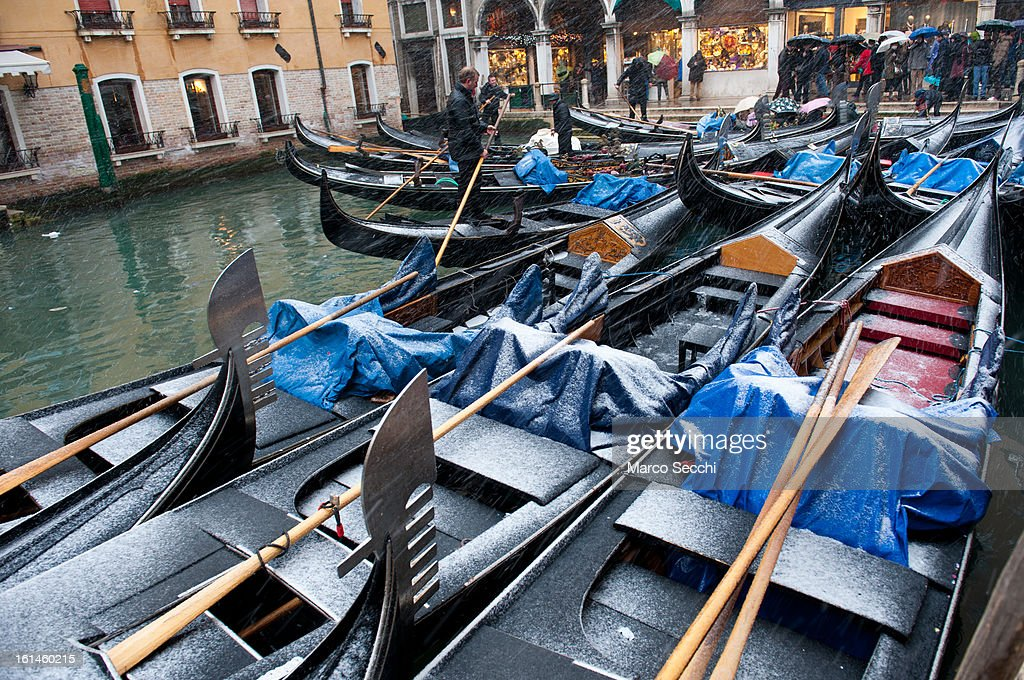 Gondolas rest in Bacino Orseolo during heavy snow on February 11, 2013 in Venice, Italy. Heavy snow, High water, wind and rain has been forcasted for today.