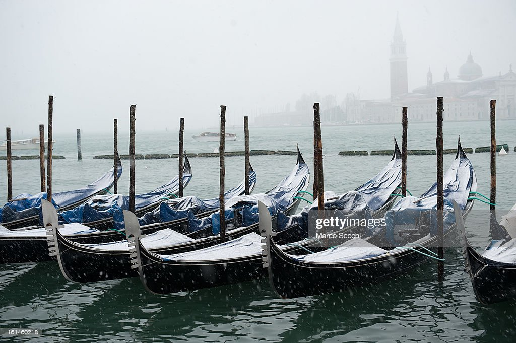 Gondolas rest in Saint Mark's Basin during heavy snow on February 11, 2013 in Venice, Italy. Heavy snow, High water, wind and rain has been forcasted for today.