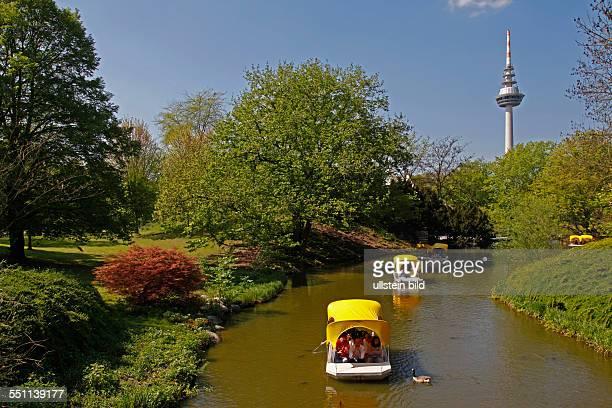 Gondoletta boats Kutzer pond telecommunication tower Luisenpark Mannheim BadenWuerttemberg Germany