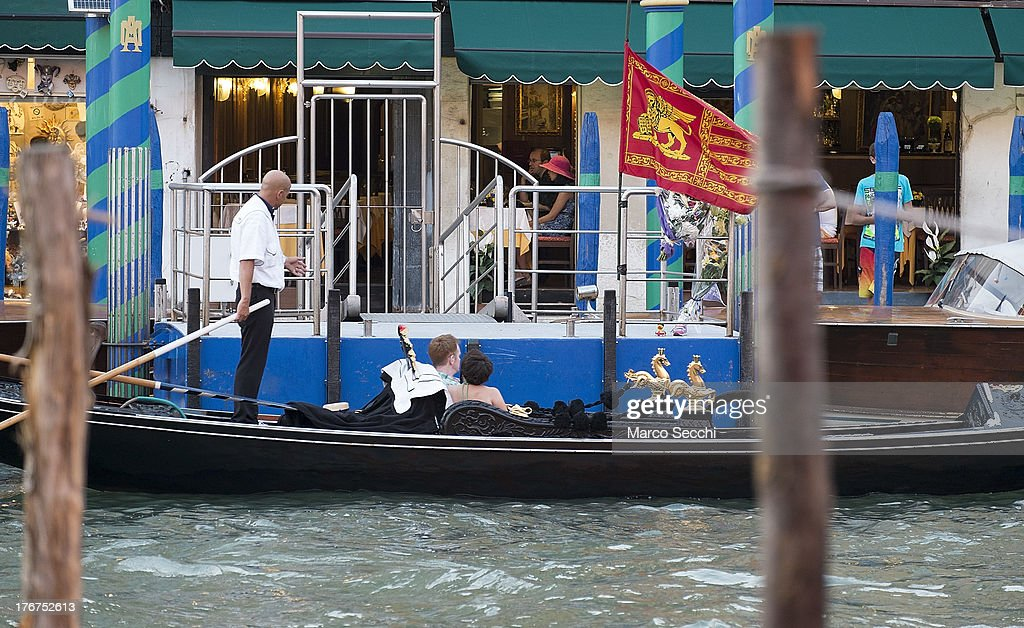 A Gondolier explains yesterday accident while sails in front of the pontoon where yesterday a German tourist was crashed to death on August 18, 2013 in Venice, Italy. A German tourist was crushed to death on Saturday when the gondola he was boarding collided with a waterbus (Vaporetto) along Venice's Grand Canal.