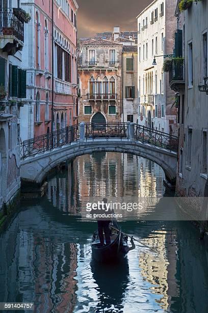 Gondolier sailing on Venice canal, Veneto, Italy
