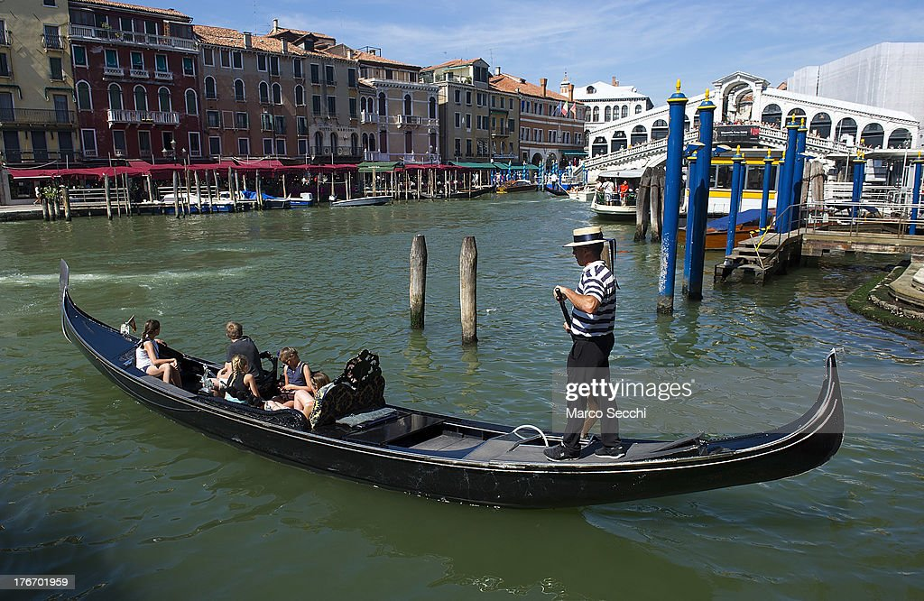 A gondolier sails along the Grand Canal near Rialto Bridge where today a German tourist was crashed to death on August 17, 2013 in Venice, Italy. A German tourist was crushed to death on Saturday when the gondola he was boarding collided with a waterbus (Vaporetto) along Venice's Grand Canal.