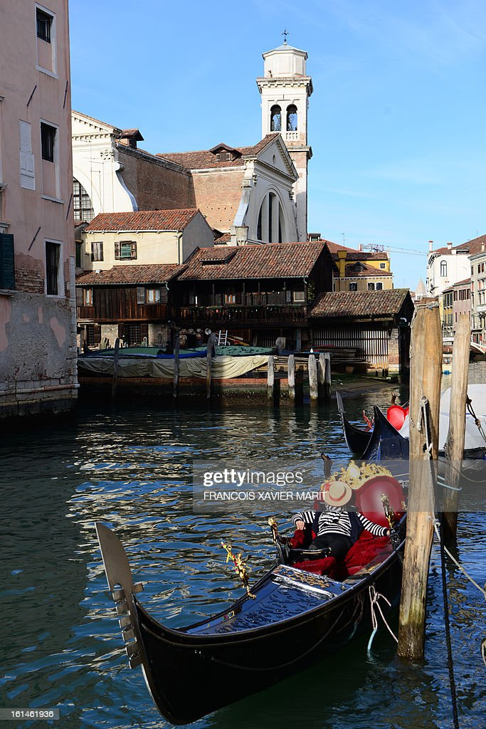 A gondolier sleeps in his gondola during the carnival on February 7, 2013 in Venice. The 2013 edition of the Venice carnival is untitled Live in Colour' and runs from January 26 to February 12.