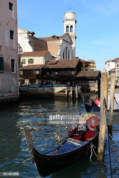 A gondolier sleeps in his gondola during the carnival on February 7 2013 in Venice The 2013 edition of the Venice carnival is untitled Live in...