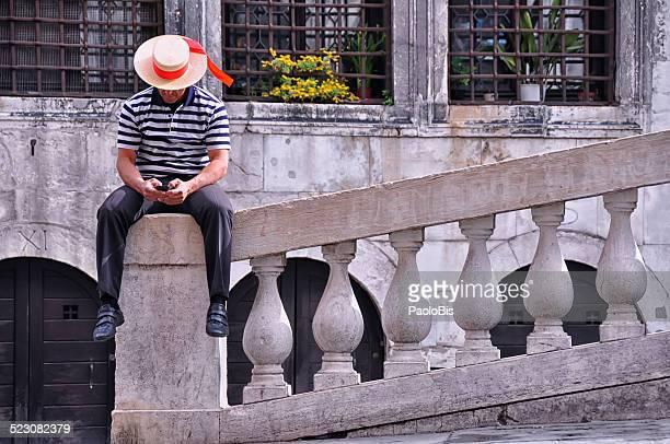 Gondolier waiting for tourists, Venice