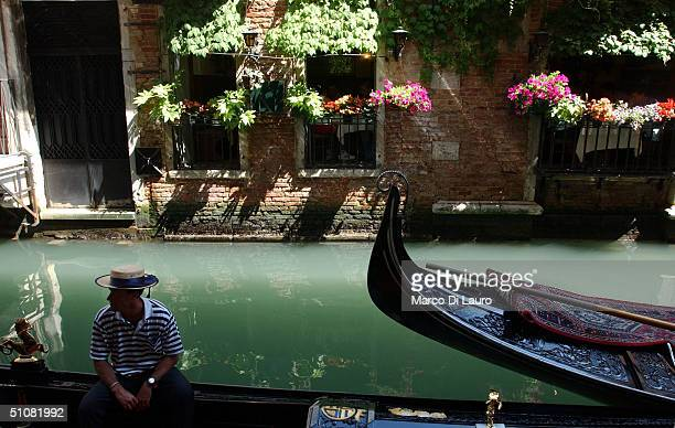 A gondolier waits for clients during the Festa del Redentore in Venice on July 18 2004 This festival is second only to the Carnival and began in 1576...