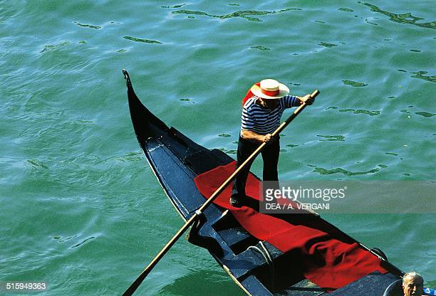 Gondolier wearing typical clothing Venice Italy