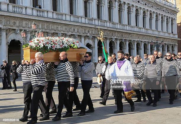 Gondoliers carry the coffin of Valeria Solesin the only Italian victim of the Paris attacks in Saint Mark's Square on November 24 2015 in Venice...