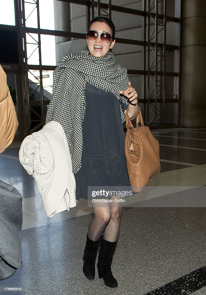 Gong Li is seen at LAX airport on March 04, 2014 in Los Angeles, California.