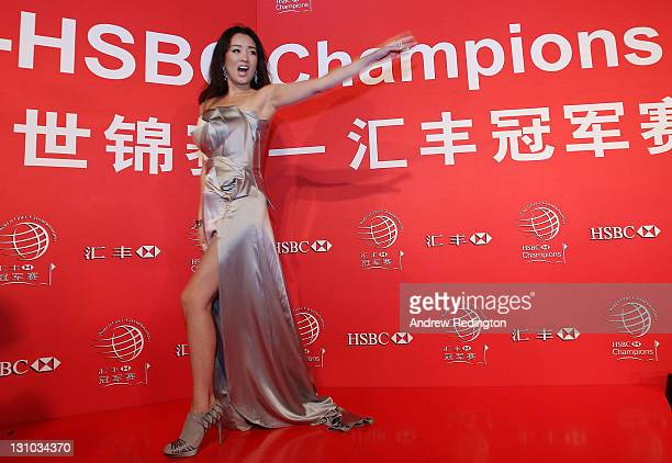 Gong Li of China waves to the fans on the red carpet during the Welcome Reception at the Waitanyuan prior to the start of the WGCHSBC Champions on...