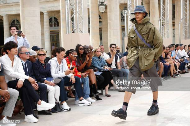 Gong Yoo Chief Executive Officer of Louis Vuitton Michael Burke his wife Brigitte Burke Jeremie Laheurte Tyga and Naomi Campbell attend the Louis...