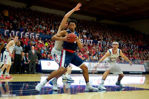 Gonzaga Bulldogs forward Johnathan Williams posts up in front of St Mary's Gaels forward Dane Pineau during the first half of the Gaels' game against...