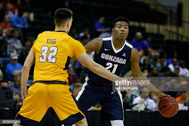 Gonzaga Bulldogs forward Rui Hachimura is defended by Quinnipiac Bobcats guard Peter Kiss during the 2016 Advocare Invitational NCAA mens basketball...