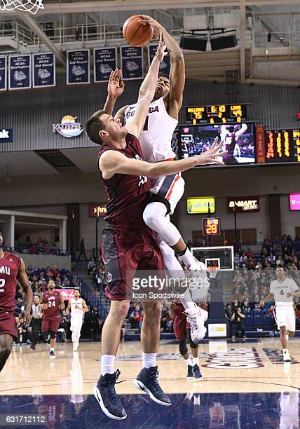 Gonzaga freshman forward Rui Hachimura dishes off an assist as LMU senior center Stefan Jovanovic defends during the game between the Loyola...