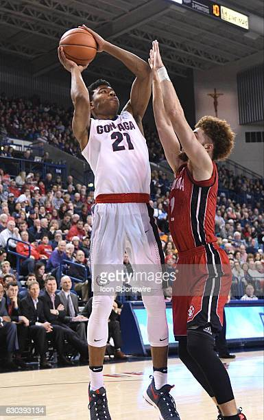Gonzaga freshman forward Rui Hachimura shoots over South Dakota sophomore forward Trey BurchManning during the game between the University of South...