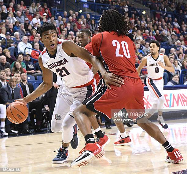 Gonzaga freshman forward Rui Hachimura tries to drive past South Dakota freshman guard Brandon Armstrong during the game between the University of...