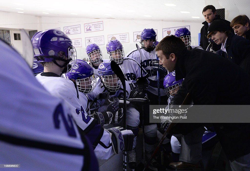 Gonzaga head coach Nate Jackson gathers his players for a time out during the championship game of the Purple Puck National Capital Hockey Tournament hosted by Gonzaga College High School on Monday, December 31, 2012. St. Ignatius (Cleveland, OH) defeated Gonzaga 2-1 for the title.