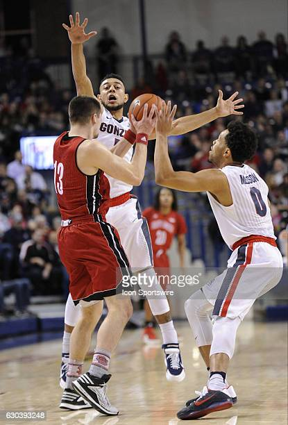 Gonzaga junior guard Nigel WilliamsGoss and junior guard Silas Melson apply defensive pressure to South Dakota sophomore guard Matt Mooney during the...