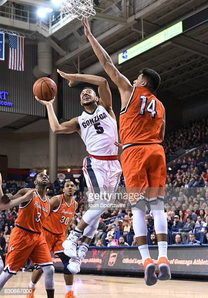 Gonzaga junior guard Nigel WilliamsGoss can't finish on this attempt as Pepperdine senior forward Chris Reyes defends during the game between the...