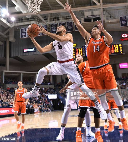Gonzaga junior guard Nigel WilliamsGoss goes up to score as Pepperdine senior forward Chris Reyes reaches in vain to defend during the game between...