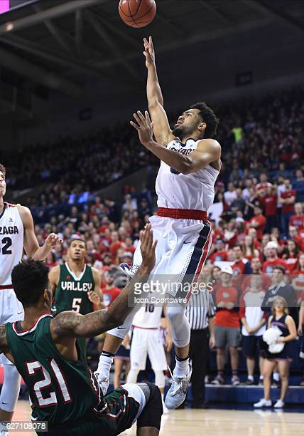 Gonzaga junior guard Silas Melson shoots as MSVU freshman forward Terence Traylor falls backwards during the game between the Mississippi Valley...