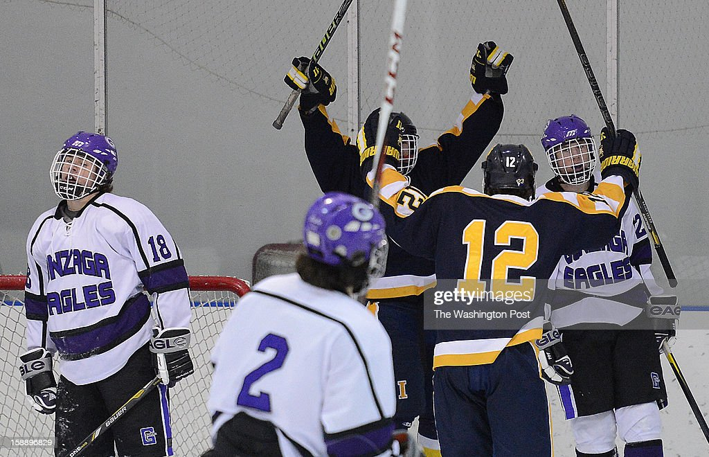 Gonzaga players react as St. Ignatius (Cleveland, OH) players celebrate after scoring the go-ahead goal during the championship game of the Purple Puck National Capital Hockey Tournament hosted by Gonzaga College High School on Monday, December 31, 2012. St. Ignatius (Cleveland, OH) defeated Gonzaga 2-1 for the title.